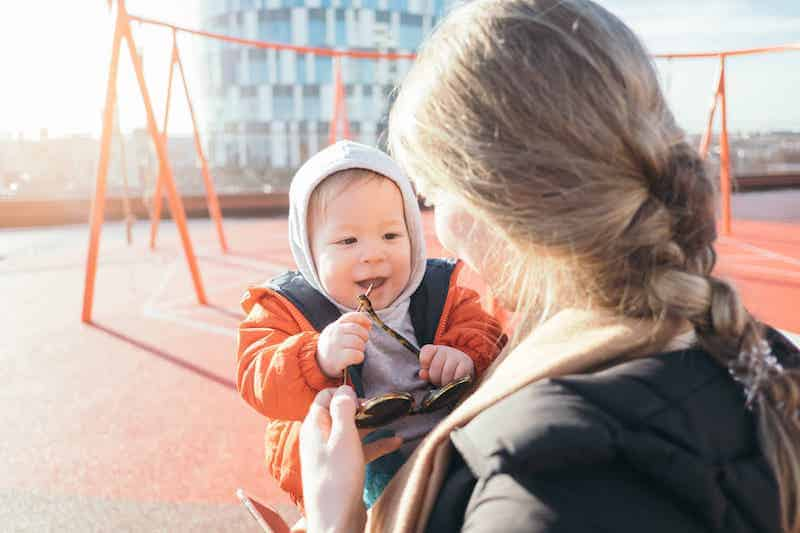 Stay-at-Home Mom Jobs: Woman Holding Baby on the Playground