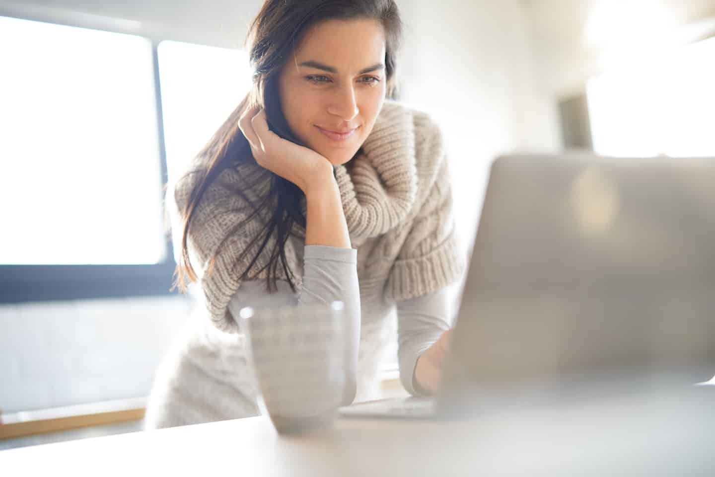 woman looking at a laptop screen