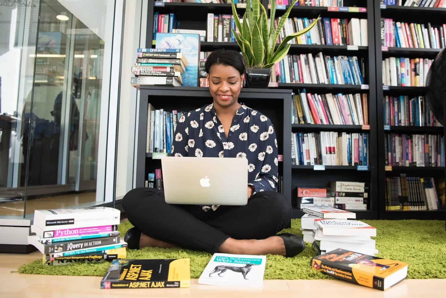 woman listing textbooks to sell online