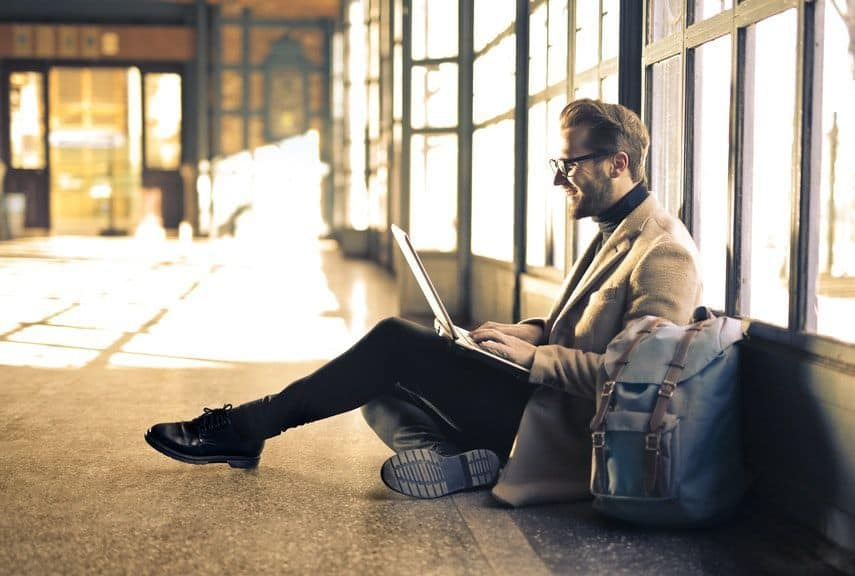 man using free internet at airport