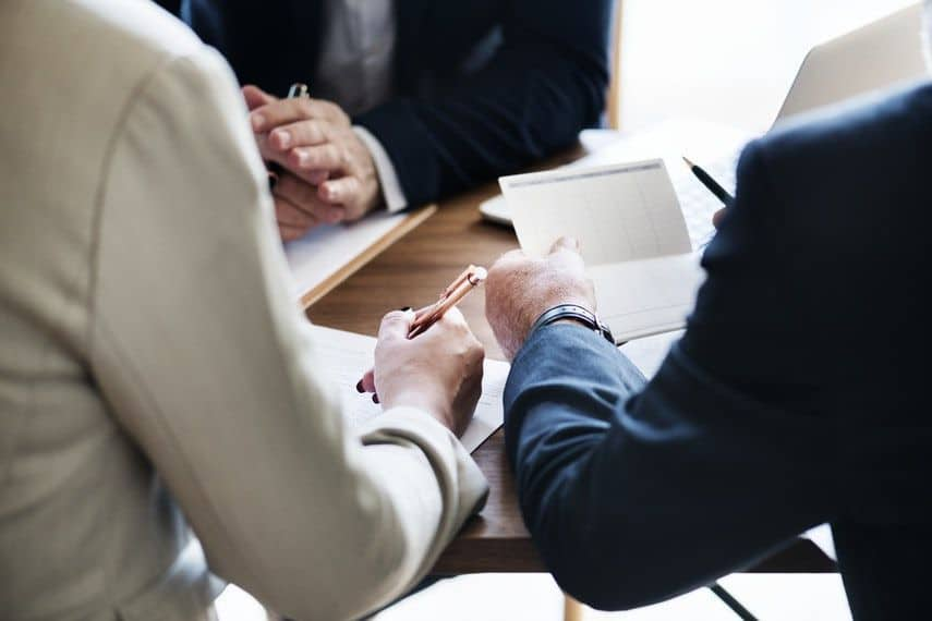 meeting with a loan officer and real estate agent