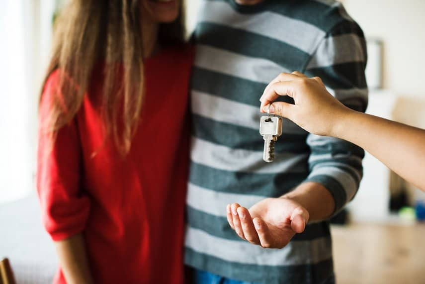 couple accepting keys