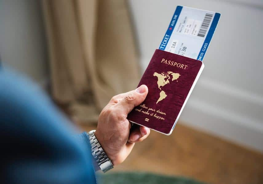 Travel Budget: Man Holding Passport