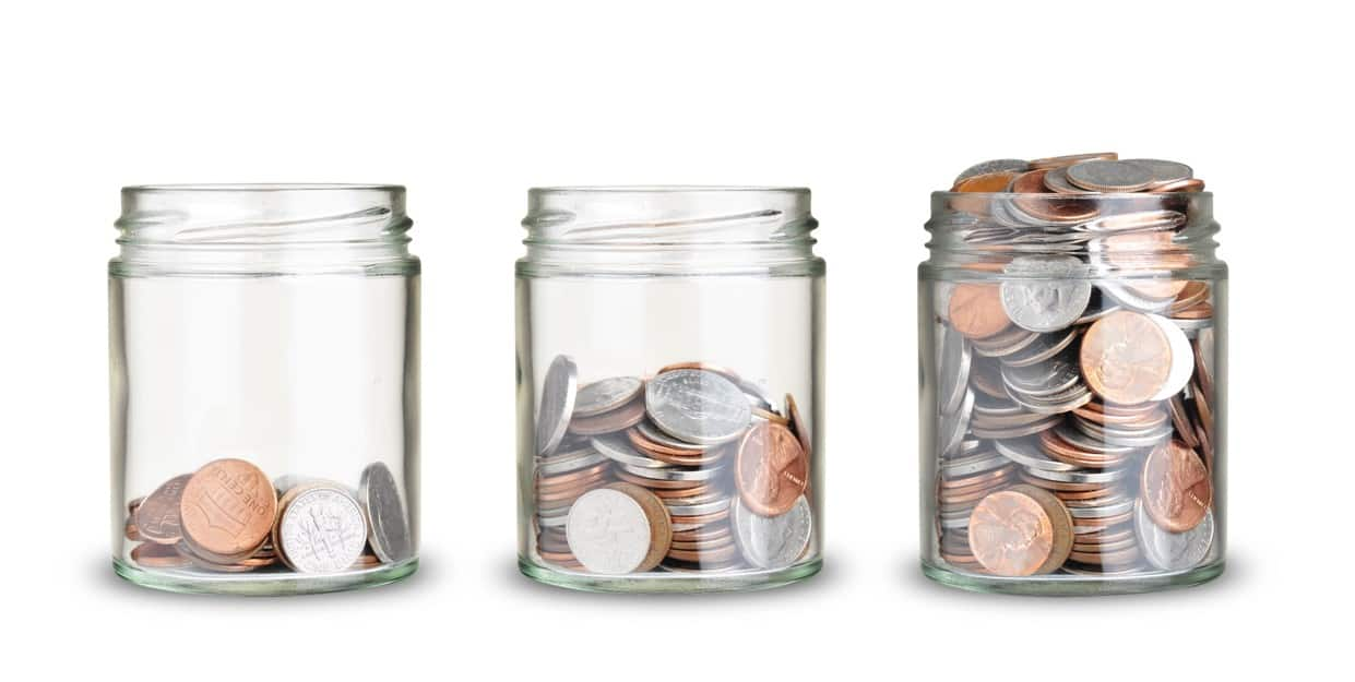 Cash back credit cards and apps are a great way to passively earn income over time- jars of coins