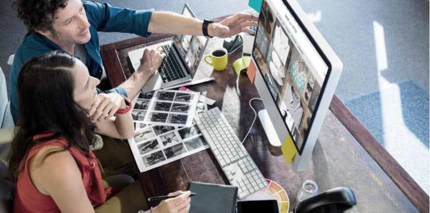 Man and woman selling stock photos online