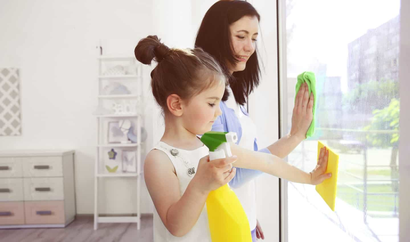 mother and daughter washing windows