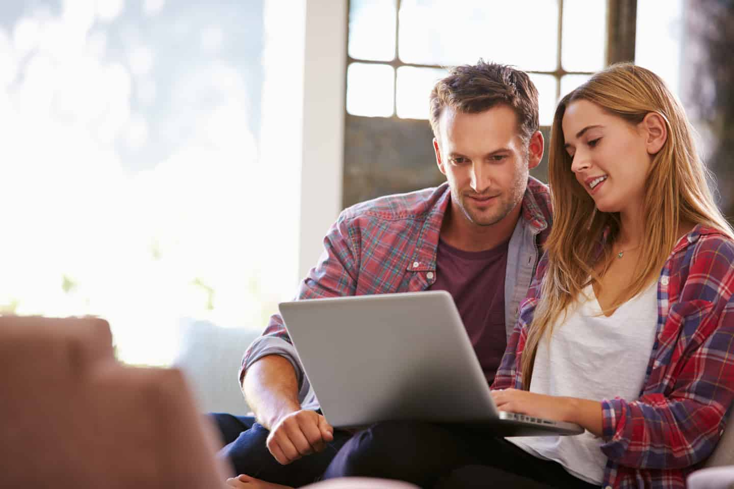 young couple opening investment accounts