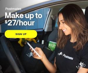 female postmates driver in car