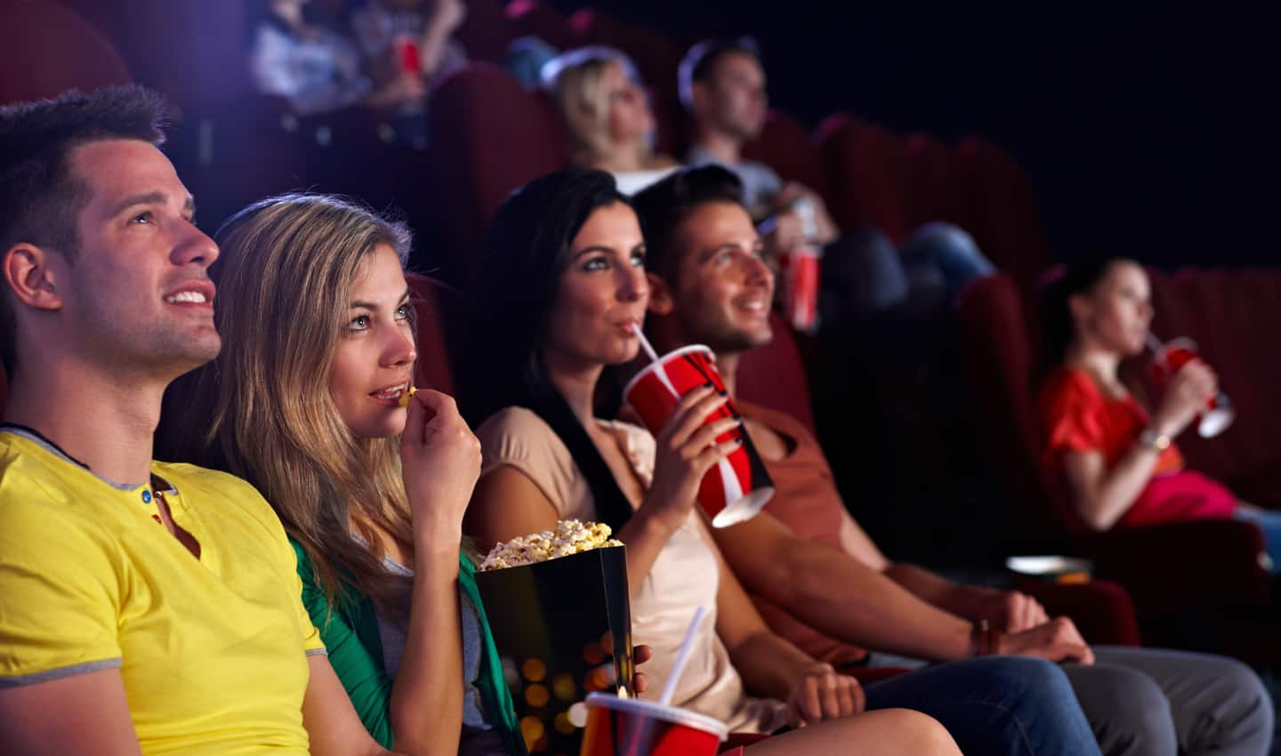 two couples enjoying a matinee showing