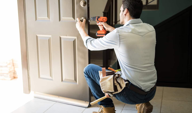 handyman fixing door knob