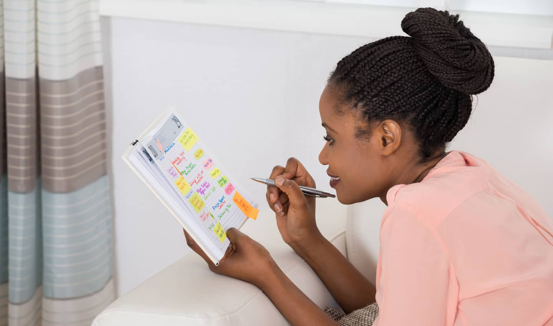 woman adding tasks to her calendar