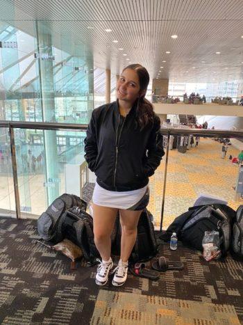 cheerleader in warm-up jacket