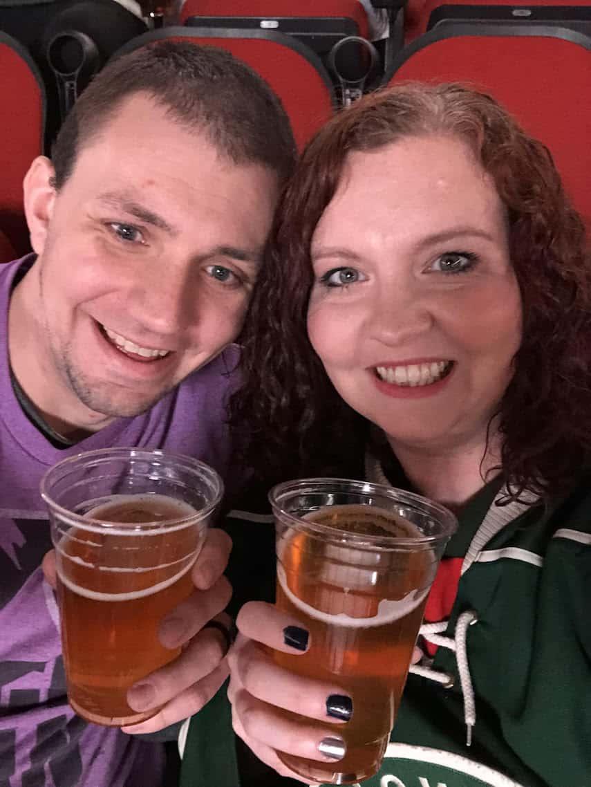 Micah Jankowski and Husband at a hockey game