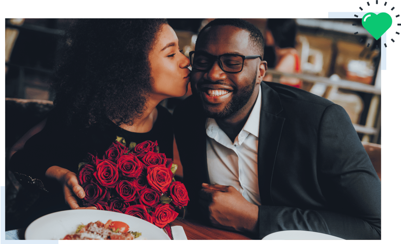man and a woman on a date with roses