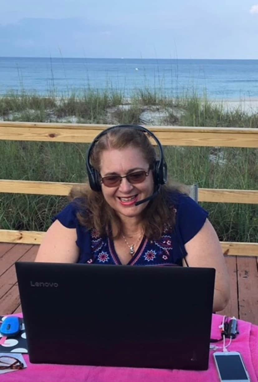 Laura Saulters Teaching with VIPKid Outside at the Beach