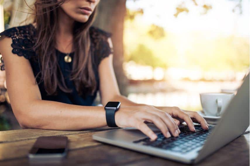 Woman researching virtual assistant services